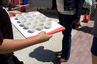 Handing out juice samples